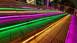 Stairs are decorated with colorful lightings.