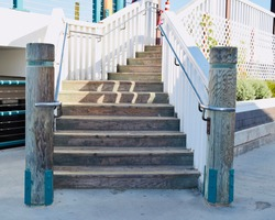 Stairs at Pier with Pylons and White Handrails