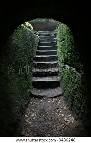 Stairs at the end of a cave...more in my portfolio. - stock photo