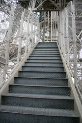 Stairs climbing the Eiffel tower  by foot to the second level
