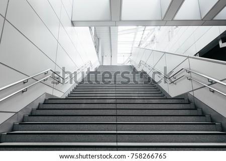 Stairs from underground upward in modern city space.