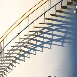 Stairs going round and up and their shadow
