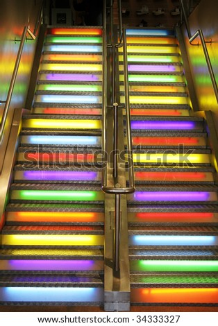 stairs in  color neon lights going up to club or disco. funky staircase