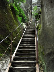 stairs lead among  sand - stone rock