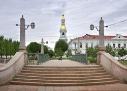 Stairs of the Krasnogvardeysky bridge. Granite railings of the Griboyedov canal embankment, bell tower of the St. Nicholas Sea Cathedral in the Russian Baroque style. Architecture of the XVIII century