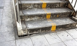 Stairs of the pedestrian overpass in the city. Stairway overpass break deep affects the structure and safety. concept, safety on dangerous public pavements