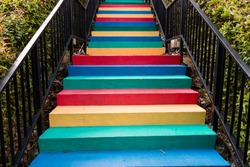 Stairs painted in rainbow colors background
