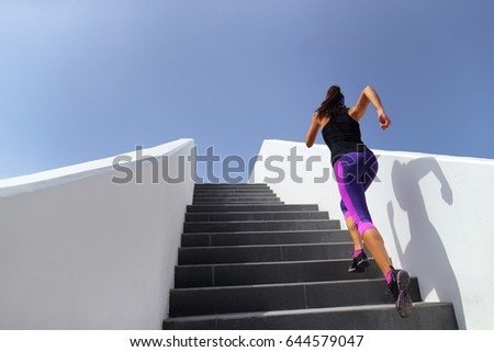 Stairs running workout woman training cardio at gym. Fitness girl exercising legs muscles outdoors with explosive exercises. #644579047