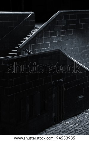 Stairs Stairs in the darkness lighted by an invisible source of light
