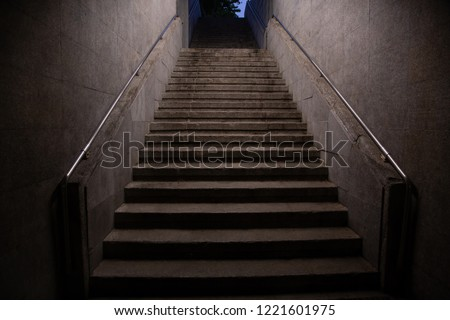 Stairs. subway staircase old in dark night secluded, concrete stairs in the city, stone granite stair steps often seen on monuments and landmarks, going up. Architectural details interiors  #1221601975
