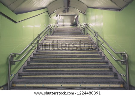Stairs. subway staircase old in interior secluded, concrete stairs in the city, stone granite stair steps often seen on metro station and landmarks, going up. Architectural interiors underground. #1224480391