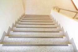 stairs terrazzo floor walkway up - down. interior building. select focus with shallow depth of field