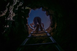 stairs through the dark pit and light