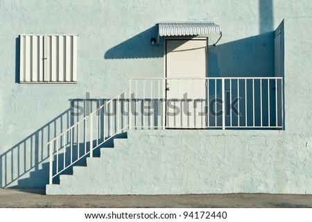 Stairs to door in light green