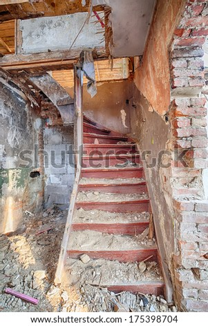 Stairs to the attic of a ruined building