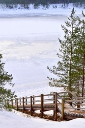 Stairs to the frozen lake in winter. Ogre, Latvia.
