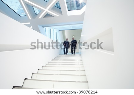 stairs up with two business men comming down