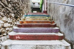 Stairs with colorful painting in an alley