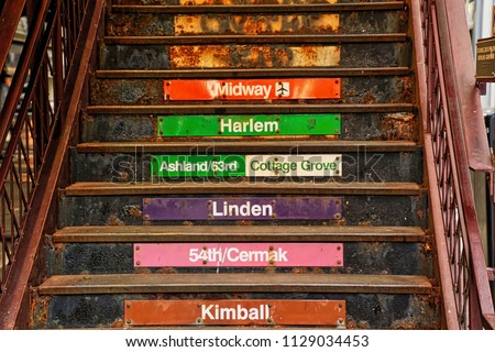 Stairs with colorful signs indicating different lines of Chicago's elevated 'El' train at station located on the corner of Adams & Wabash Streets. Stock fotó ©