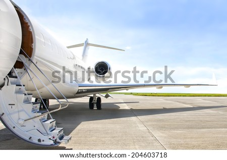 Stairs with Jet Engine on a modern private jet airplane