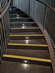 Stairs with lighting and yellow anti-slip treads and nosings.