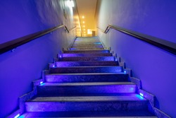 Stairs with purple lights. Purple duotone color effect.