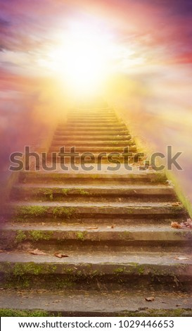 Stairs with sun beams .  Way to heaven . Beautiful sky  .