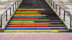 Stairway concept  in the form of pencils of rainbow colors contrasted photo