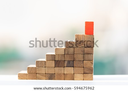 stairway of wood blocks with red block on top.