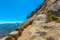 Stairway steps of the top of Moro Rock trail in summer in California, United States of America in Sequoia National Park.