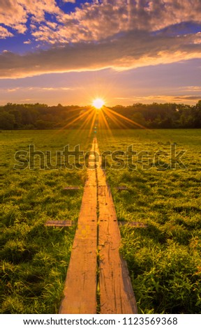 Stairway to heaven trail at sunset. Beautiful sunset viewed from Pinwheel Vista, New Jersey featuring boardwalk leading to the sun on the background