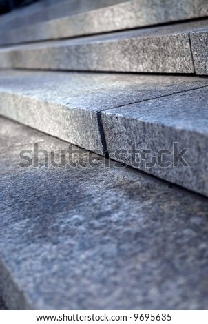 Stairway with granite stone steps in perspective close up