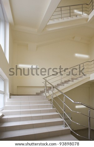 Stairway with metal handrails in the new modern building
