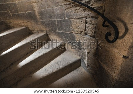 Stairway with metal railing in a medieval castle, Avignon in France