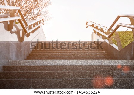 Stairway with metallic banister. The concept of success or climbing #1414536224