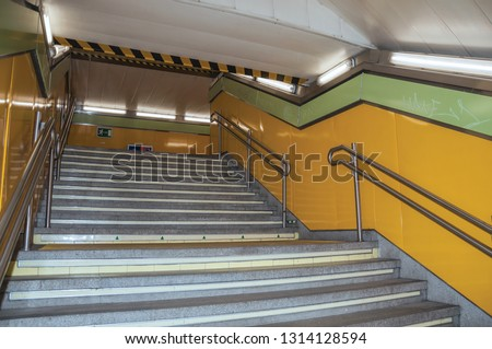 Stairway with steel handrail in a passageway linking modern stations at the Madrid Subway. Capital of Spain this charming metropolis has vibrant and intense cultural life. #1314128594