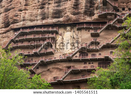 Stairways, caves and grottoes at Maijishan Grottoes, Tianshui, Gansu, China with huge Bodhisattva sculptures. Construction began at late fourth century CE. National heritage. #1405561511