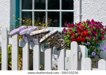 STAITHES, NORT YORKSHIRE/UK - AUGUST 21 : Two pairs of boots placed on fence posts in Staithes North Yorkshire on August 21, 2010