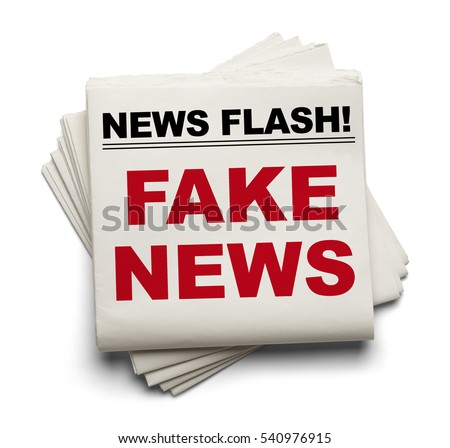 Stake of Newspapers That Say Fake News Isolated on White Background. #540976915