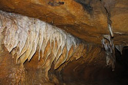Stalactite is a term taken from the Greek word for dripping. Stalactites are a type of speleothem or secondary minerals that hang from the ceiling of the cave.