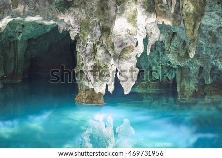 Shutterstock Stalactite over the water