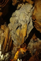 Stalactites found in Chiang Dao Cave, Chiang Mai Province, Thailand. A stalactite is a type of formation that hangs from the ceiling of caves. Soft focus and there are noise.