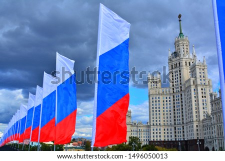 Stalin skyscaper and many Russian flags against cloudy sky #1496050013