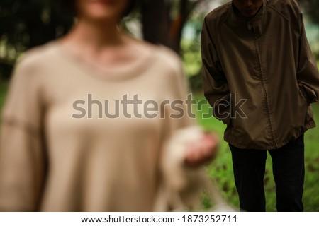 Stalker image: A man chasing a woman Сток-фото ©