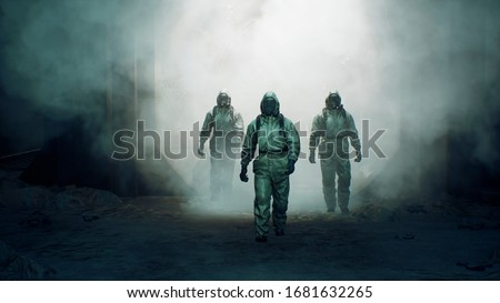 Stalkers in military protective clothing and a gas mask are walking along an abandoned and deserted metro. The concept of a post-apocalyptic world after a nuclear war. 3D Rendering