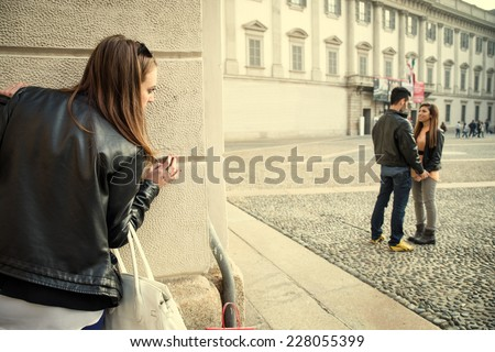 Stalking - Ex girlfriend spying her ex boyfriend with another woman - stalking,infidelity and jealousy concepts