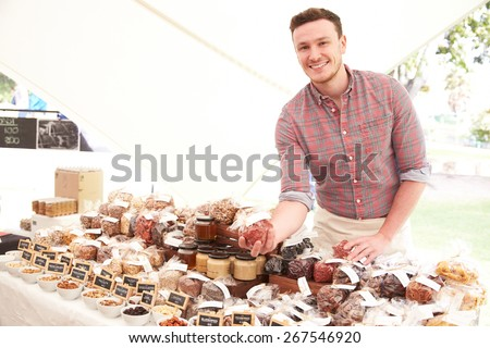 Stall Holder At Farmers Food Market Selling Nuts And Seeds