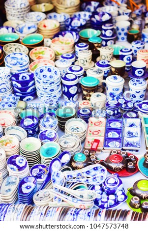Stall with ceramics items in the street market in Hoi An, Vietnam #1047573748