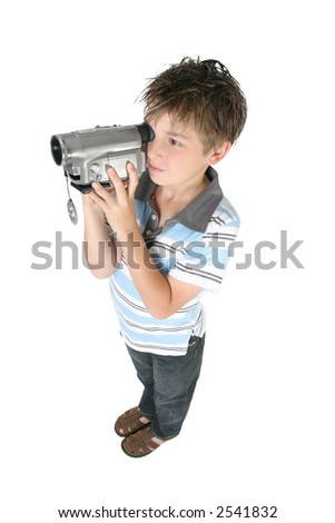 Stamding boy filming with a digital video camera.   White background,