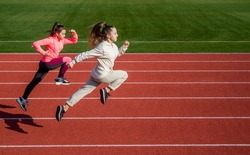 stamina. teenage girls run marathon. runner on race competition. sprinter warming up on stadium gym. children training at school physical education lesson. speed and motion. Just flying